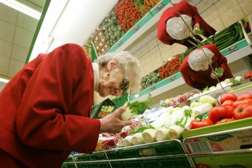Elderly German Christine Evelt, 78, who is visually impaired, shops for groceries at her local store in the northern town of Greven