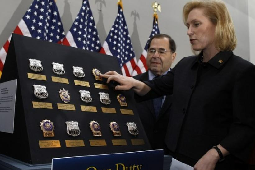 U.S. Sen. Kirsten Gillibrand, D-NY, touches the replica police badge of Detective James Zadroga before a news conference calling for the passage of The James Zadroga 9/11 Healthcare and Compensation Act on Capitol Hill in Washington, November 29, 2010.
