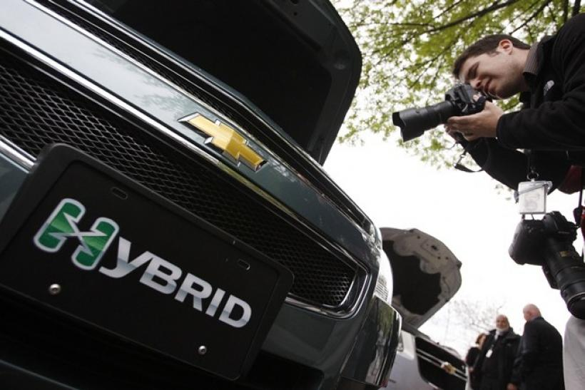 A photographer takes a picture of a Chevy Malibu hybrid car on display on West Executive Drive at the White House in Washington April 22, 2009.