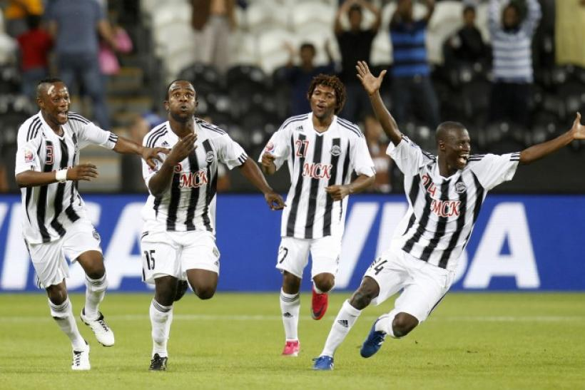 Kasusula of Congo's TP Mazembe celebrates with teammates after their Club World Cup semi-final soccer match against Brazil's Internacional at Mohammed Bin Zayed Stadium in Abu Dhabi.