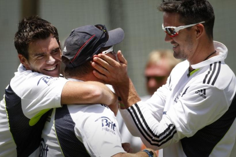 Anderson and Pietersen joke around with bowling coach Saker during a practice session at the WACA ground in Perth.