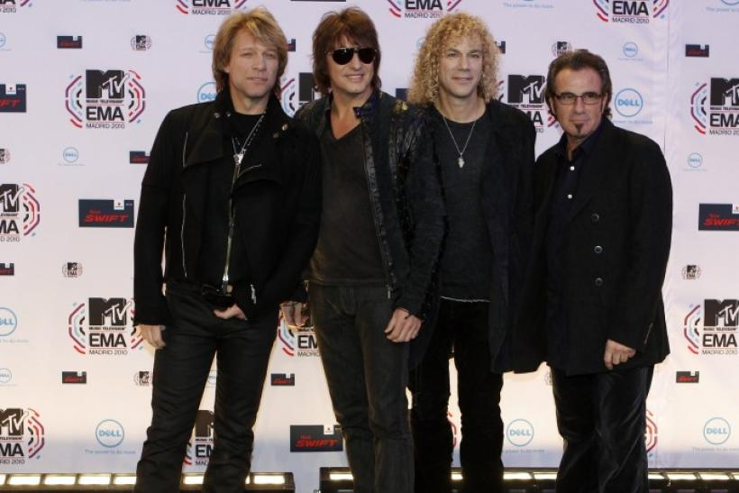 Members of Bon Jovi pose for photographers as they arrive for the MTV Europe Music Awards 2010 in Madrid