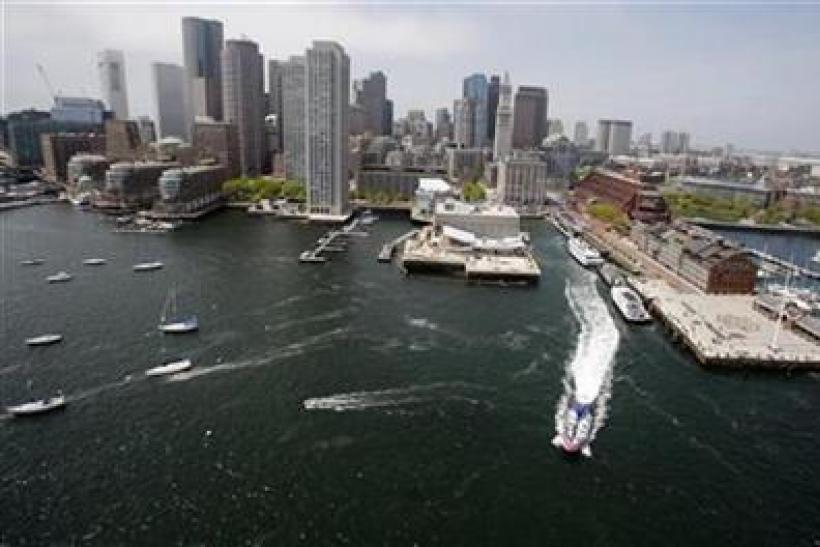 The skyline of Boston, Massachusetts is seen from over Boston Harbor