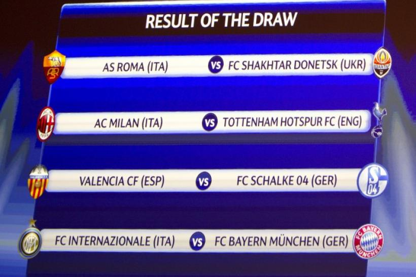 A screen shows the results of the draw for the Champions League first knockout round soccer matches at the UEFA headquarters in Nyon