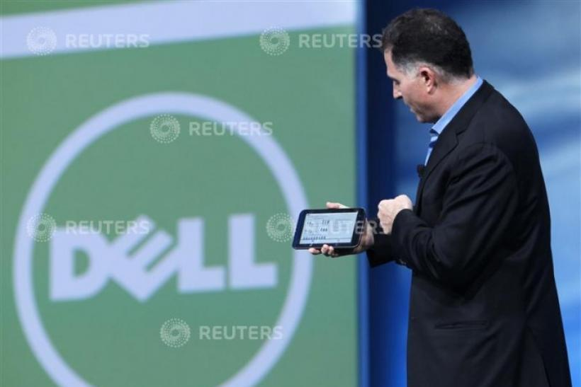 Dell founder and CEO Michael Dell displays a Dell tablet computer in San Francisco