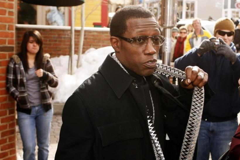 Actor Wesley Snipes gestures on the street during the Sundance Film Festival in Park City, Utah