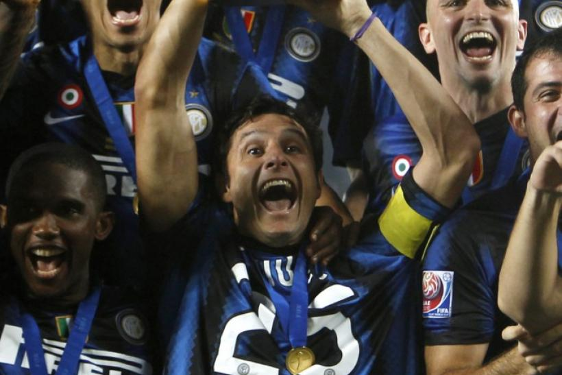 Javier Zanetti of Italy's Inter Milan lifts the Club World Cup 2010 trophy after winning their final soccer match against DR Congo's TP Mazembe at Zayed Sports City in Abu Dhabi.
