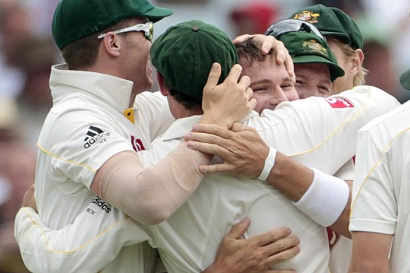 Teammates congratulate Harris for taking the wicket of Prior during the third Ashes cricket test in Perth.