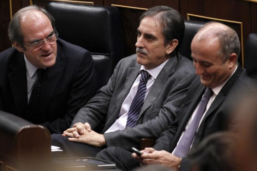 Spain's Education Minister Gabilondo talks to Labour Minister Gomez and Industry Minister Sebastian at Spanish parliament in Madrid