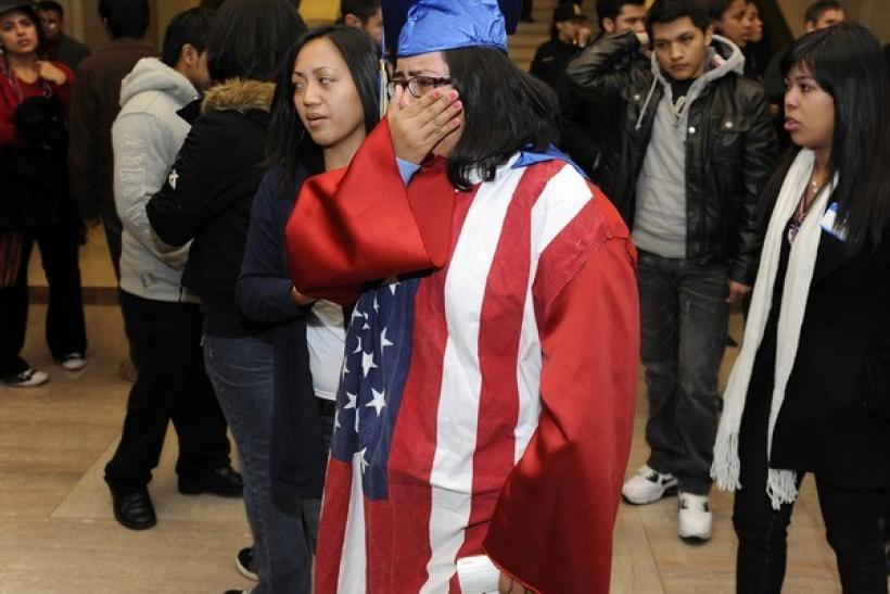 "Students, some wearing graduation caps and gowns, cry after watching from the senate gallery as opponents block passage of the ""Dream Act"" at the U.S. Capitol in Washington, December 18, 2010."