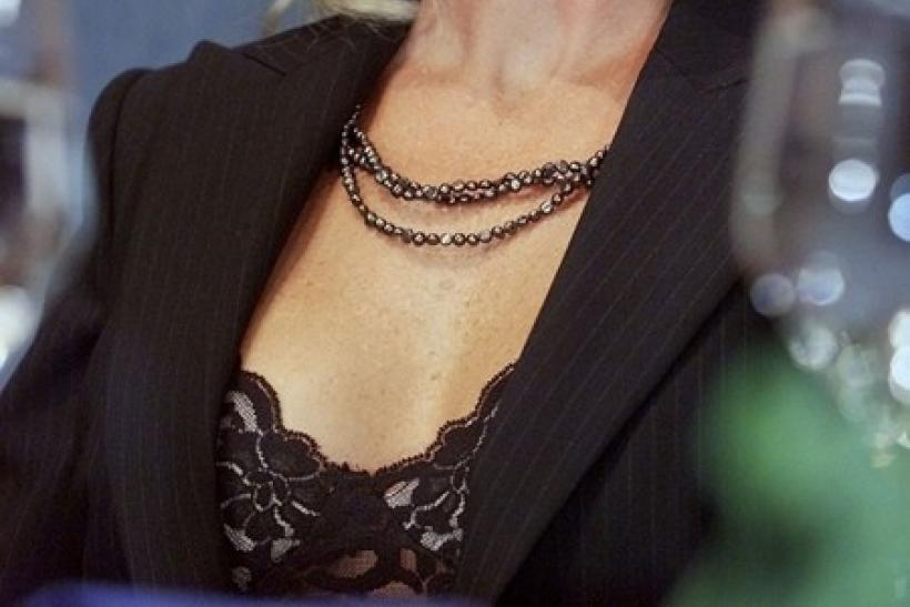 Environment activist and subject of a Hollywood movie Erin Brockovich smiles before speaking to a gathering of journalists at the National Press Club in Washington, August 16, 2001.