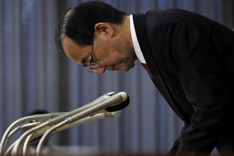 Bank of Japan Governor Shirakawa bows to greet reporters after a news conference at the BOJ headquarters in Tokyo