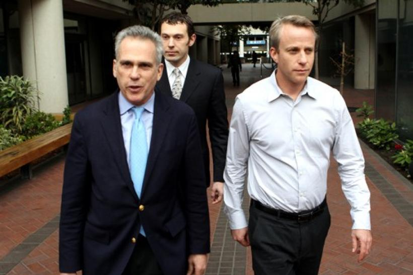 James Fleishman (R) walks out of the Robert Peckman United States Courthouse with his attorney Stuart Gasner (L) after appearing in federal court on insider trading charges in San Jose, California December 16, 2010