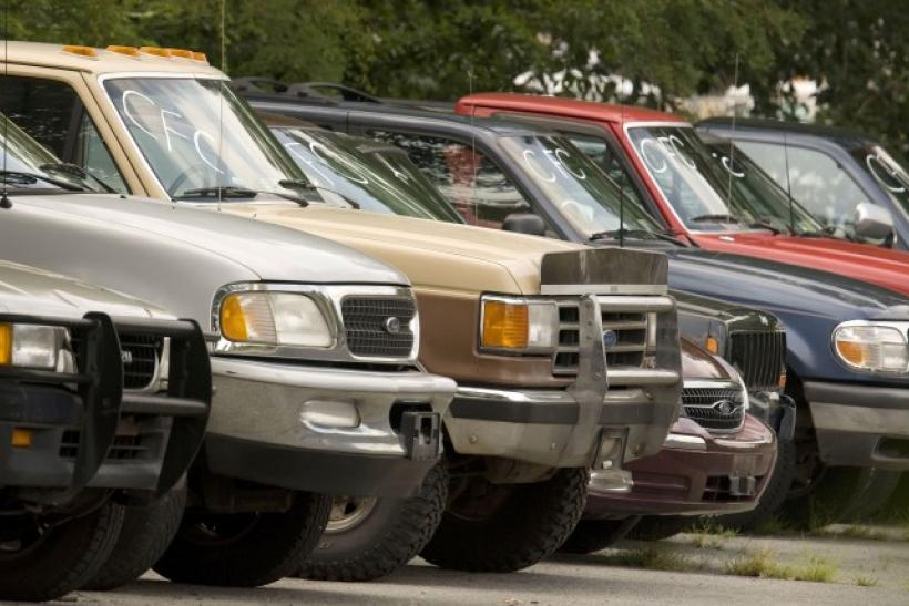 Used cars from the Cash-for-Clunkers program sit in the Ted Britt Ford dealership storage lot in Fairfax, Virginia