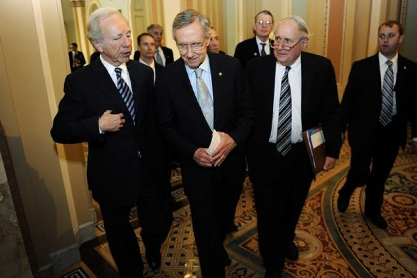 U.S. Senators, left to right, Joseph Lieberman, I-CT, Senate Majority Leader Harry Reid, D-NV, and Carl Levin, D-MI, (D-MI) at the U.S. Capitol in Washington, December 18, 2010.