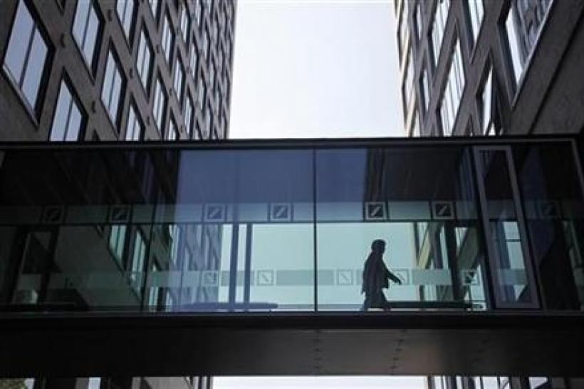 An employee of the Deutsche Bankwalks along a passageway between buildings at the Deutsche Bank headquaters in Frankfurt
