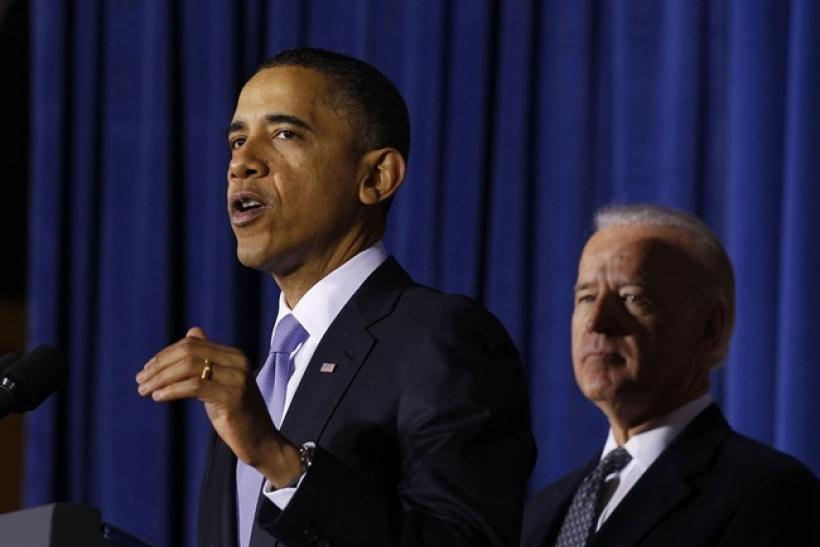 U.S. President Barack Obama (L) speaks before signing the Don't Ask, Don't Tell Repeal Act of 2010 into law as Vice President Joseph Biden listens at the U.S. Department of Interior in Washington, December 22, 2010. Obama said Wednesday that implementing