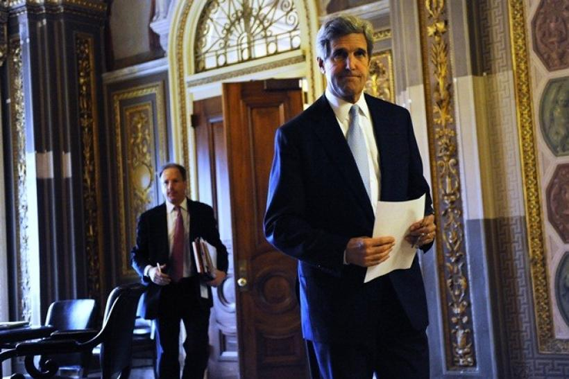 U.S. Senator John Kerry (D-MA) (Right) walks to the Senate floor during debate over ratification of the START treaty at the U.S. Capitol in Washington, December 22, 2010.
