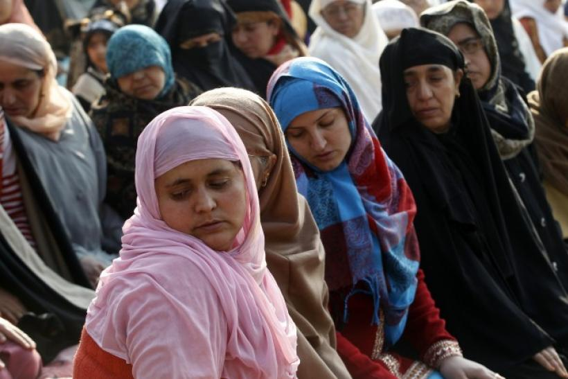 Kashmiri Muslim women offer prayers during the Eid al-Adha festival in Srinagar