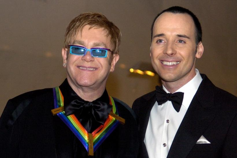 Sir Elton John becomes father.