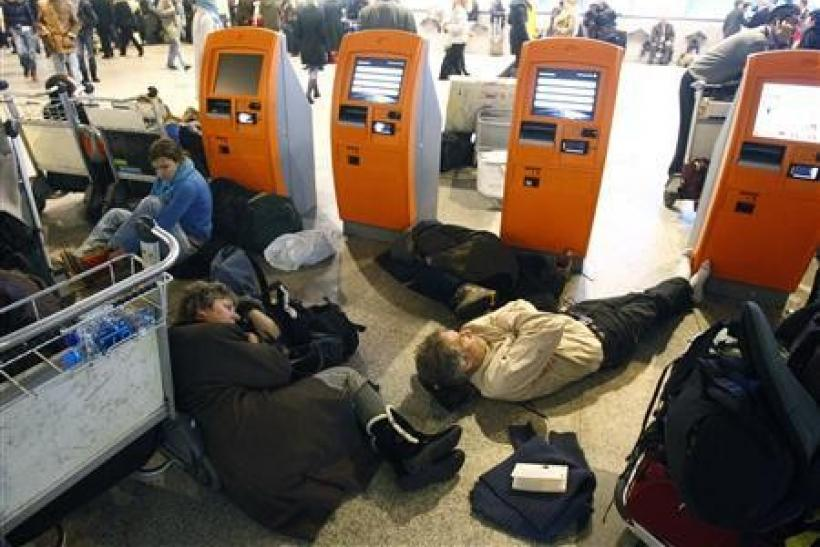 Passengers sleep at the departure hall of Moscow's Domodedovo airport