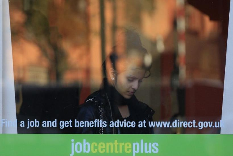 A woman enters an employment centre in Leicester, central England