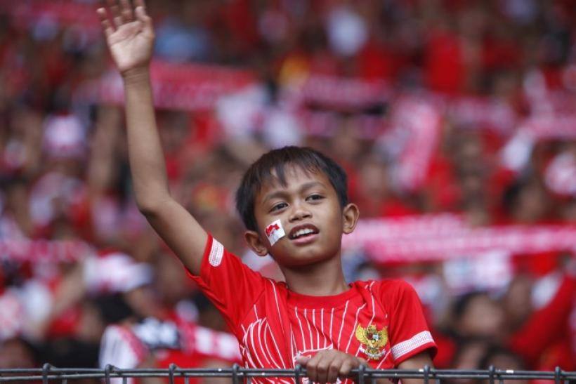Young Indonesian fan cheers before start of final match against Malaysia during AFF Suzuki Cup 2010 soccer tournament in Jakarta