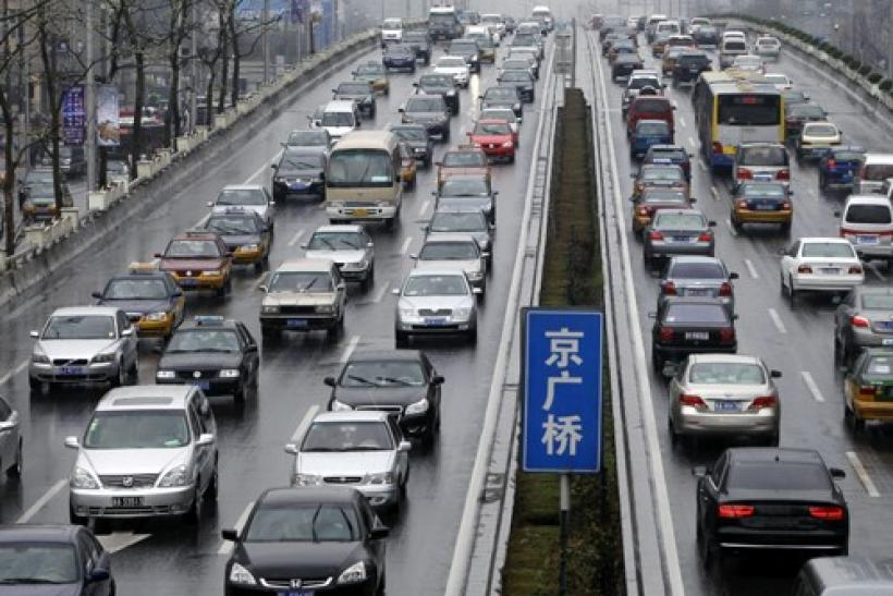 Vehicles are seen on a road in Beijing