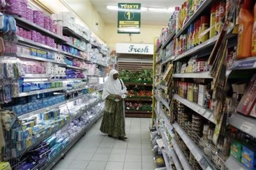 A woman shops at a supermarket in Nairobi