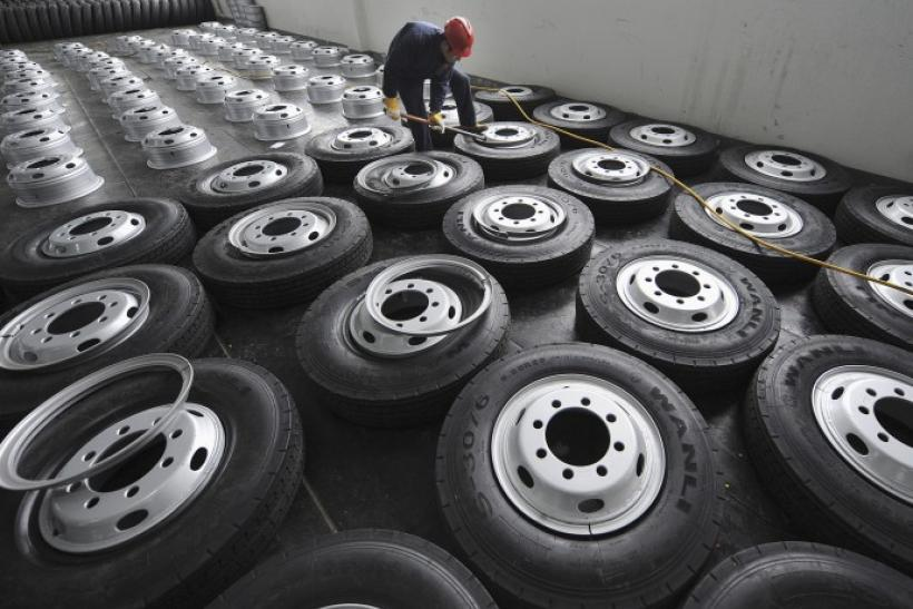 An employee installs tire rims at a factory of Zhengxing Wheel Group in Hefei.
