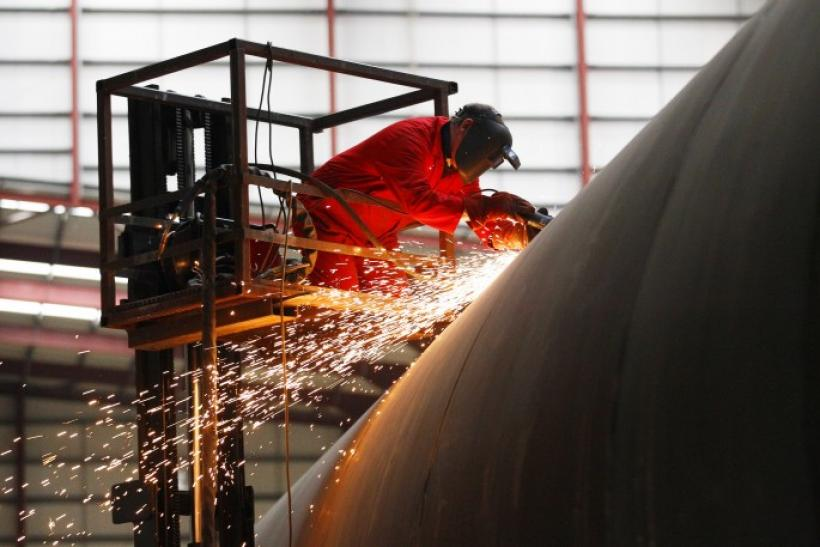 An welder works on a section of a Pelamis wave energy converter at their factory in Edinburgh, Scotland.