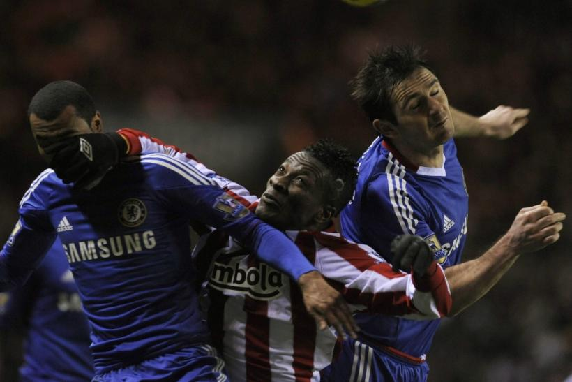 Chelsea's Cole and Lampard challenge Sunderland's Gyan during their English Premier League soccer match in Sunderland.
