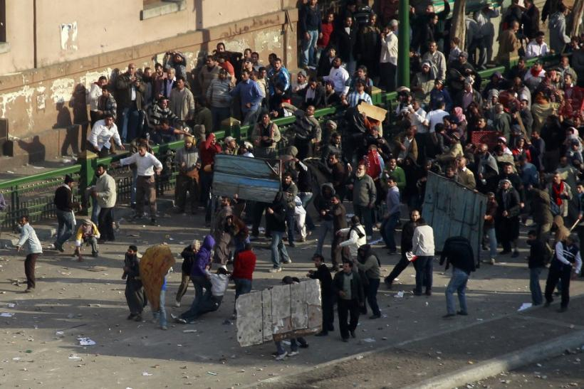 Pro-government protesters clash with anti-government protesters in Tahrir square