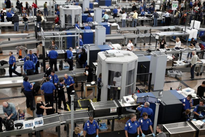 TSA workers carry out security checks at Denver International Airport, the day before the Thanksgiving holiday in Denver.