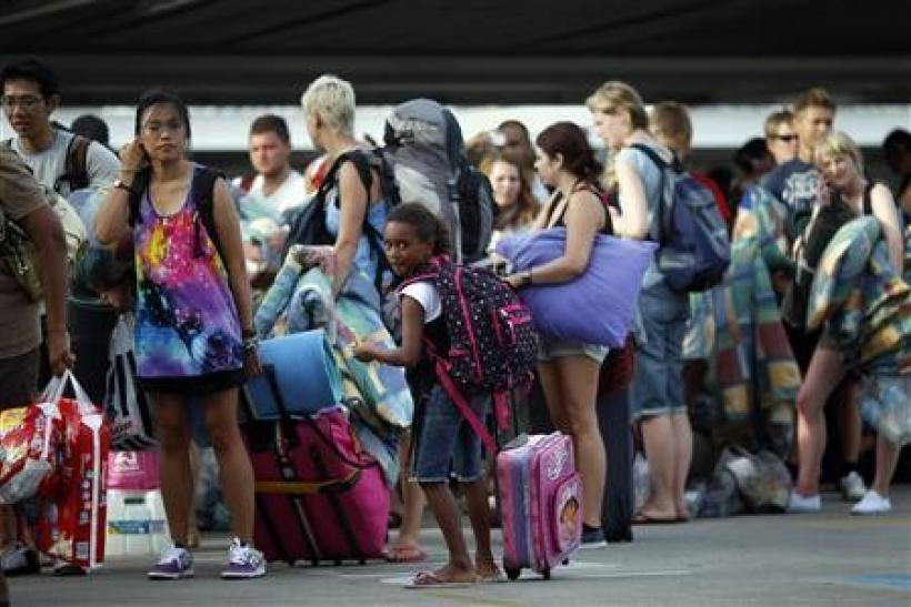 A girl waits in line to enter an emergency cyclone shelter in a shopping mall in the northern Australian city of Cairns