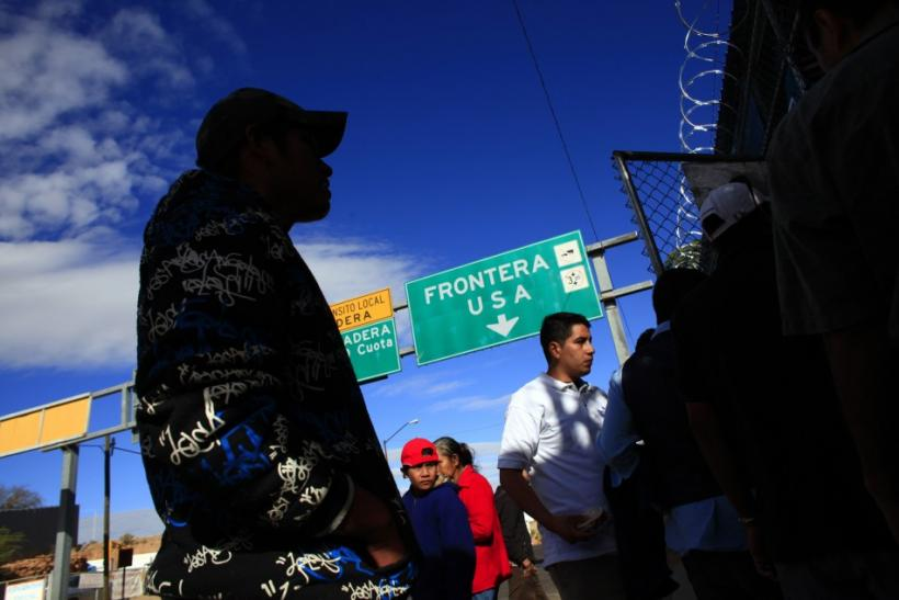 People wait outside an aid center near a truck port of entry in Nogales, Mexico