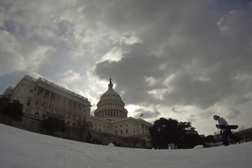 Lindsay Cronin carries her snowboard back up the hill in front of the U.S. Capitol Building in Washington January 27, 2011.