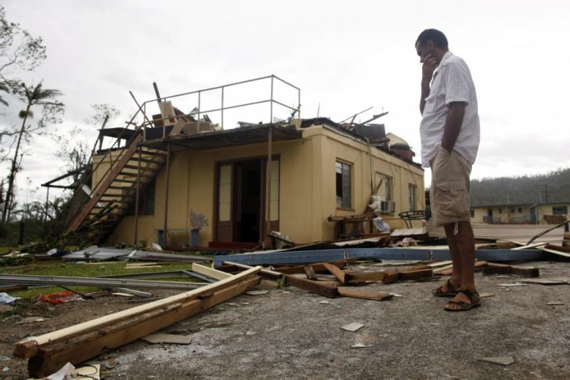 A man stands near his friend's ruined house after Cyclone Yasi passed the northern Australian town of Tully