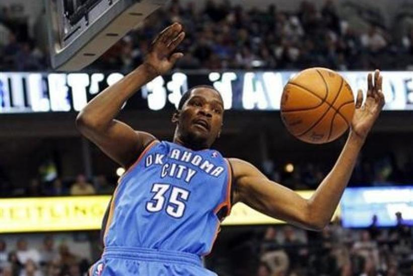 Oklahoma City Thunder forward Kevin Durant dunks against the Dallas Mavericks during the second half of their NBA game in Dallas, Texas January 6, 2011.