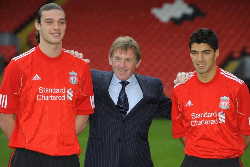 Liverpool soccer club's new signings Carroll and Suarez pose for photographers with coach Dalglish at Anfield stadium in Liverpool.