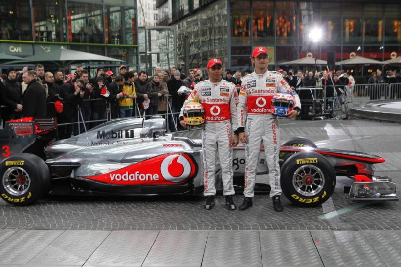 McLaren Formula One racing drivers Hamilton and Button of Britain pose for pictures during revealing of McLaren Mercedes MP4-26 racing car in Berlin.