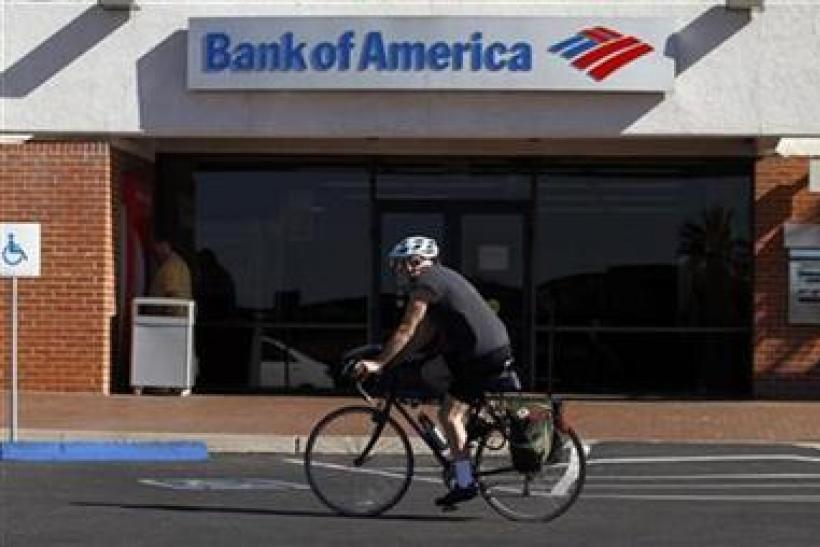 A bicyclist rides past a Bank of America in Tucson