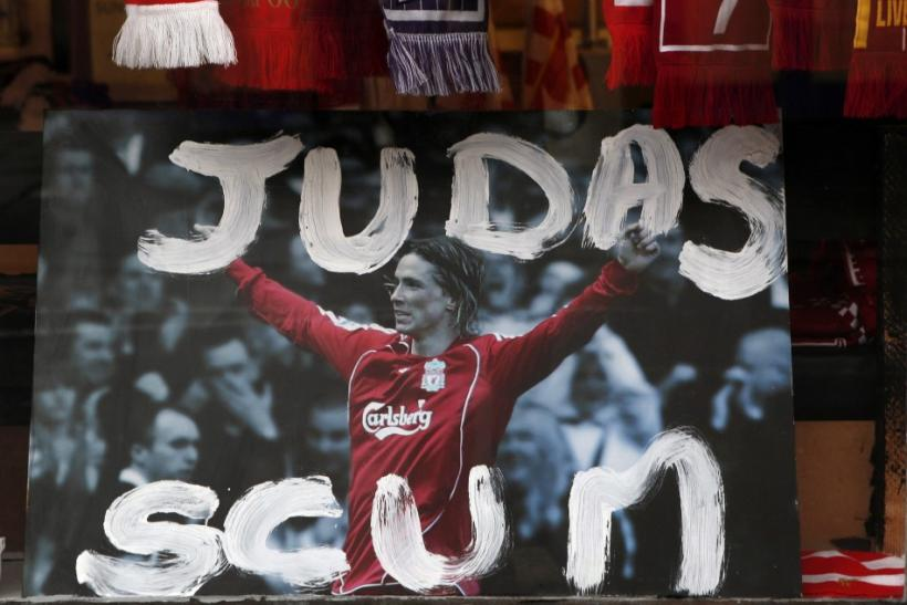 Defaced Fernando Torres photograph is displayed in the window of a souvenir shop in Liverpool.