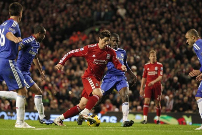 Ex-Liverpool man Torres runs through the Chelsea defence in their previous encounter against each other, in which he scored two goals for Liverpool against his new team.