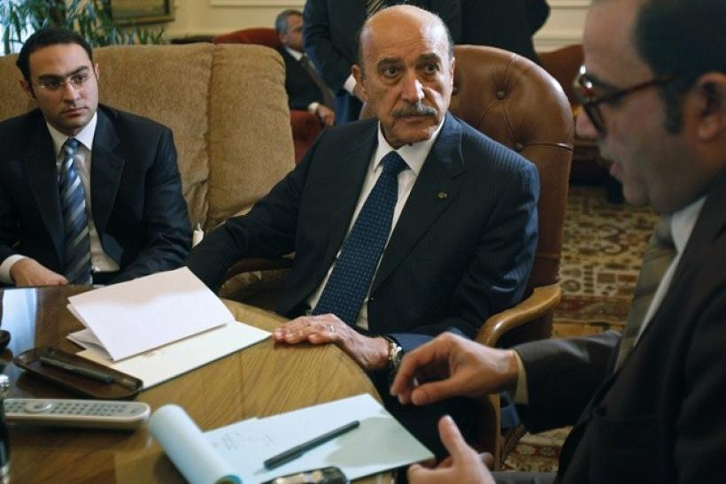 Egyptian Vice President Omar Suleiman talks to representatives from political parties in the Prime Minister's office in Cairo February 6, 2011. Suleiman held talks on Sunday with opposition groups including the officially banned Muslim Brotherhood to try