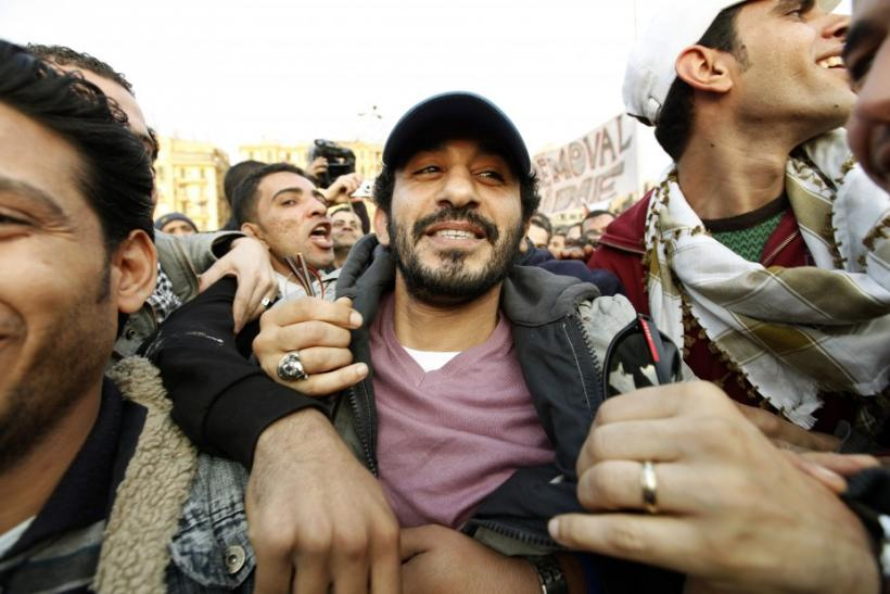 Anti-government protesters embrace Egyptian actor Ahmed Helmy as he visits demonstrations inside Tahrir Square in Cairo
