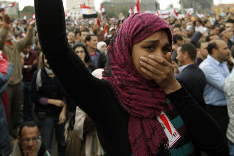 A protester holds back her tears as she chants anti-government slogans during demonstrations at Tahrir Square in Cairo