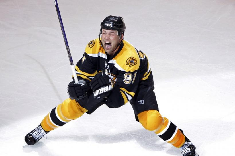 Bruins center Savard celebrates after scoring the game winning goal against the Flyers during the first overtime period in Game 1 of their NHL Eastern Conference semi-final hockey game in Boston.
