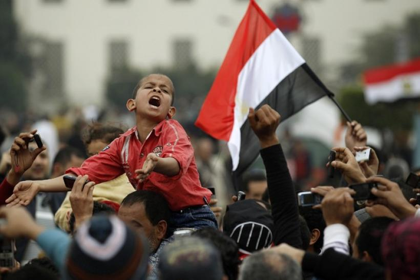 A young protester chants anti-government slogans during demonstrations inside Tahrir Square in Cairo