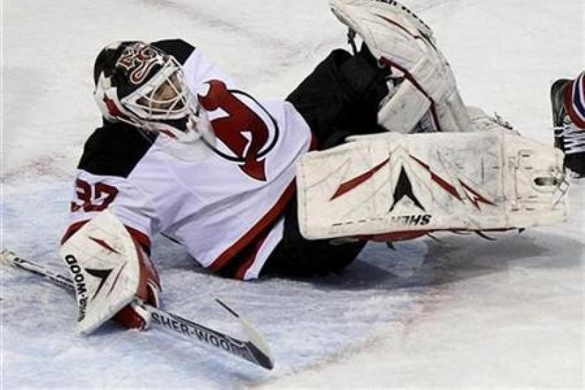 New Jersey Devils goalie Martin Brodeur (30) is injured during first period NHL hockey action against the Montreal Canadiens in Montreal, February 6, 2011.